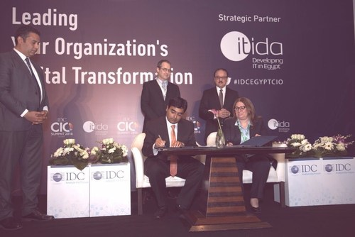 Signing ceremony between ITIDA's CEO Asmaa Hosny (Right) and Jyoti Lalchandani IDC's vice president and  ...
