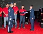 Brig. Gen. Michael Rothstein accepts commemorative U.S. flag from Chris Felton, a Lockheed Martin F-35 production employee, at the 100th F-35 Inauguration.  (PRNewsFoto/Lockheed Martin Aeronautics Company)