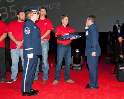 Brig. Gen. Michael Rothstein accepts commemorative U.S. flag from Chris Felton, a Lockheed Martin F-35 production employee, at the 100th F-35 Inauguration. (PRNewsFoto/Lockheed Martin Aeronautics Company) (PRNewsFoto/LOCKHEED MARTIN AERONAUTICS ...)