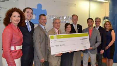 (Left to Right, in Photo) Nancy McInroy, National Director of Development and Stewardship, Autism Speaks; Kerry Margo, Social Marketing Coordinator, Autism Speaks; Scott Newman, Chief Financial Officer, Autism Speaks; Michael Rosen, Executive Vice President, Strategic Communications, Autism Speaks; Denise Bianchi, Executive Assistant -- Marketing, Awareness & Events, Autism Speaks; Gary Jaworski, Senior Vice President of Development, Autism Speaks; Kenneth Alumbaugh, Merchandise Manager, DSW Inc; Michael MacDonald, President and CEO, DSW Inc; Lisa Goring, Vice President of Family Services, Autism Speaks.  (PRNewsFoto/DSW Inc.)