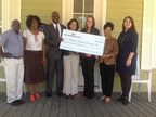 Project Build a Future Executive Director Nicole Miller (center left) accepts a $2,000 Partnership Grant Program award from First Federal Bank of Louisiana and the Federal Home Loan Bank of Dallas.