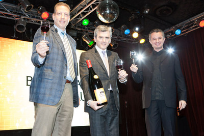 From left: Peter Deutsch, Franck Duboeuf, and Marco Tempest toast to the arrival of the Georges Duboeuf Beaujolais Nouveau 2012.  (PRNewsFoto/Les Vins Georges Duboeuf)