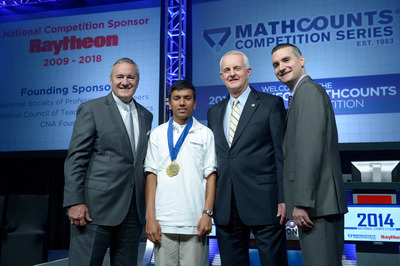 Photo 1 – Raytheon Chairman William H. Swanson (left), MATHCOUNTS Chair, Bob Miller (center), and Executive Director of MATHCOUNTS, Lou DiGioia congratulate Swapnil Garg, an 8th-grader from Sunnyvale, Calif. for taking home the 2014 Raytheon MATHCOUNTS® National Champion title. The competition brings together 224 top middle school Mathletes® from across the United States.
