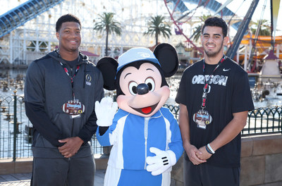 (December 27, 2014) - Florida State quarterback Jameis Winston (left) and Oregon quarterback Marcus Mariota (right), the two most recent Heisman Trophy winners, pose with Mickey Mouse in front of Mickey's Fun Wheel in Disney California Adventure park in Anaheim, Calif., on Saturday during their teams' first official Rose Bowl Game week appearance. (Scott Brinegar/Disneyland)