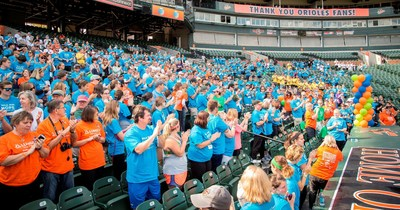 The crowd at LUNGevity Foundation's Breathe Deep Baltimore at Oriole Park gives a standing ovation to the lung cancer survivors in attendance (in green). (PRNewsFoto/LUNGevity Foundation)
