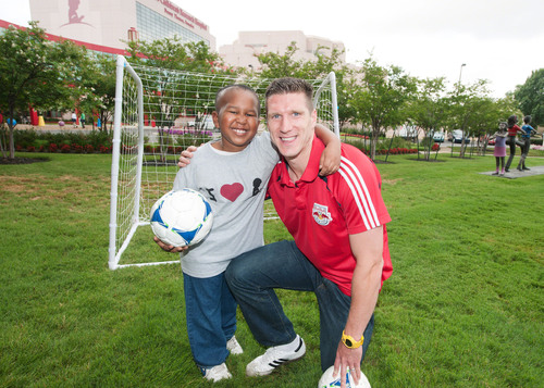 Goals for St. Jude ambassador Kenny Cooper from the New York RedBulls played soccer with St. Jude patient Marion during Cooper's recent visit to St. Jude Children's Research Hospital.  (PRNewsFoto/St. Jude Children's Research Hospital)