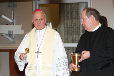 Most Reverend George J. Rassas, Auxiliary Bishop of the Archdiocese of Chicago and Brother Daniel McCormick, C.F.A., Provincial of the Immaculate Conception Province of the Congregation of Alexian Brothers lead the blessing of the new Alexian Brothers Women & Children's Hospital.  (PRNewsFoto/Alexian Brothers Health System)