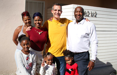 Lakeisha and her family with Alfonzo, their VASH Housing Specialist.
