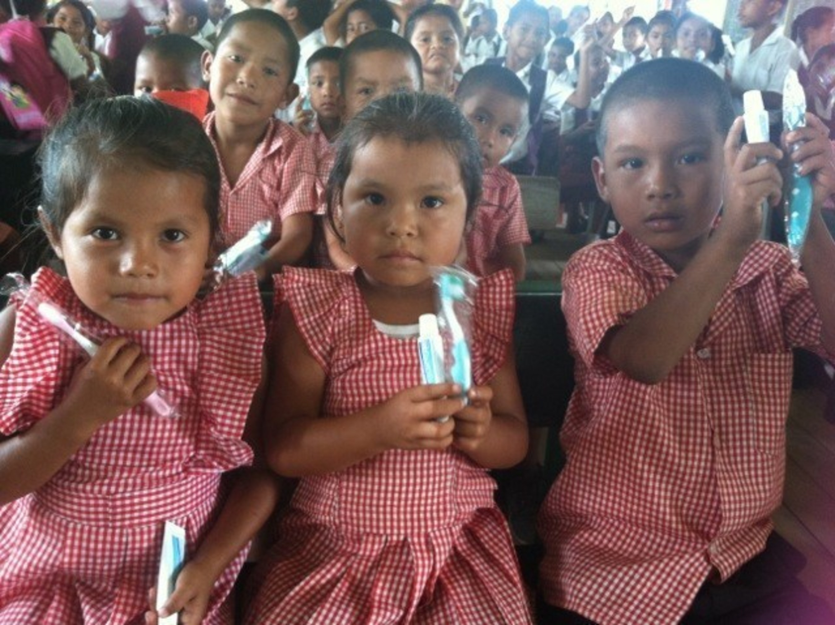 Students in Haimaracabra, Guyana learn about the importance of brushing and flossing during a health education session led by Peace Corps volunteers.