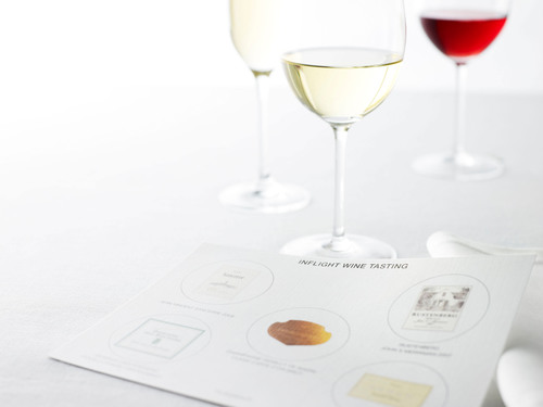 First Class customers can now enjoy an inflight wine sampling.  (PRNewsFoto/American Airlines)
