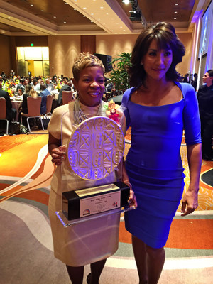 "Glenda Gill, Vice President at Supplier Success, poses with emcee Lauren Sanders, Morning Anchor at WDIV Detroit, after being presented the ""Keep Hope Alive Award"" at 17th Annual Rainbow PUSH/CEF Global Automotive Summit."
