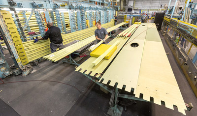 Production Operations team members work on a wing that is part of the first LM-100J commercial freighter at the Lockheed Martin site in Marietta, Georgia. The LM-100J is the commercial variant of the proven C-130J Super Hercules. (Photo by Todd R. McQueen)