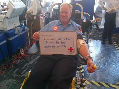 Retired FDNY firefighter David Forland gives blood with the American Red Cross in honor of his fallen comrades.Red Cross Photo By: Kara Lusk Dudley