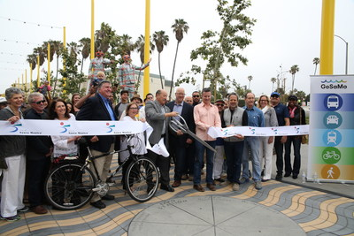 Santa Monica Mayor Tony Vazquez cuts the ribbon at the grand opening of the Colorado Esplanade, a new pedestrian and bikeway connecting the Downtown Santa Monica Expo Station to the Santa Monica Pier. Also photographed (left to right): Assistant City Manager, Elaine Polachek; Construction Manager, Gene Higginbotham; Councilmember Sue Himmelrich; Councilmember Kevin McKeown; Councilmember Gleam Davis; Mayor Tony Vazquez; Mayor Pro Tempore, Ted Winterer; Councilmember Terry O'Day; Metro Executive Officer...