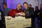 Michell Sanchez of Latin House Grill won $10,000 at the Amstel Light Burger Bash during the Food Network & Cooking Channel South Beach Wine & Food Festival on Feb. 20, 2015, and the opportunity to have his burger featured on Red Robin's Finest premium burger menu later this year. Red Robin's Best of the Bash Award, presented by celebrity chef Marc Murphy of Food Network's Chopped, was based on criteria such as creativity, taste and presentation.