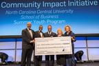 Ronald C. Parker, president and CEO of The Executive Leadership Council and Foundation (l), presents Dr. Debra Saunders-White (2nd from right) chancellor of North Carolina Central University, a $350,000 grant for a youth education program. Also participating was Lynton Scotland, Michael C. Hyter, chairman of The Executive Leadership Foundation (ELF) board and managing director, Korn/Ferry International, and Tracey Gray-Walker (r). The grant was provided under ELF's Community Impact Initiative, a national program aimed at closing the achievement gap among black middle and high school students. (Photo by Imagine Photography).  (PRNewsFoto/Executive Leadership Council)