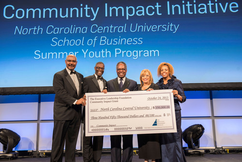 Ronald C. Parker, president and CEO of The Executive Leadership Council and Foundation (l), presents Dr. Debra ...