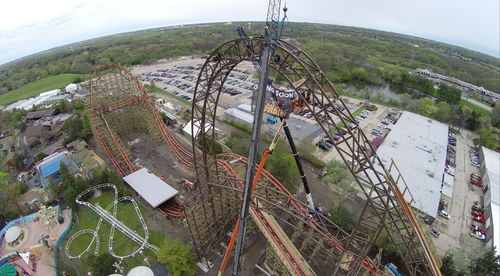 Six Flags Great America tops off near vertical, 85 degree and 180-foot drop on triple-world-record breaking ...