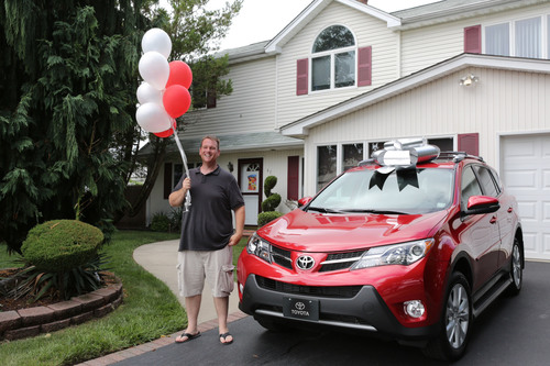 Toyota's 50 millionth customer and NYPD vet Michael Dee stands beside his brand-new 2013 RAV4.  ...