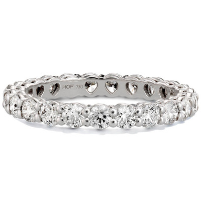 The new Multiplicity Love Collection comes in a variety of styles and carat weights in the Eternity Band (featured in image), as well as five-stone and seven-stone diamond bands. The hidden hearts inside the band are the new signature of Hearts On Fire and will also be included in many future versions of Hearts On Fire designs.  (PRNewsFoto/Hearts On Fire)