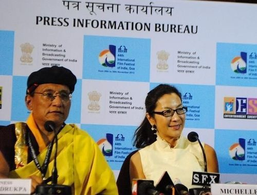 PR NEWSWIRE INDIA - The Gyalwang Drukpa and Michelle Yeoh addressing the press at IFFI 2013 (PRNewsFoto/Live to Love)
