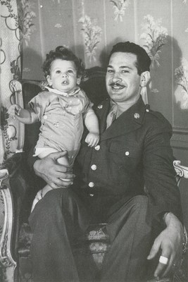 Hy Frank holding his son, Rich, when he returned to the United States following deployment in Europe during World War II