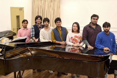 Indian musicians at Middlesex University in London. The group, from AR Rahman's KM Music Conservatory, are amongst the first students to arrive in the UK as part of a new educational partnership with Middlesex University. Pictured (left to right) are Middlesex/KMMC students Altamash Ansari from Allahabad, Aditya Akkapeddi from Hyderabad, Anurag Sharma from Delhi, Abinav Sridharan from Chennai, Tshering Leezum Bhutia from Sikkim, Sachin Shankor Mannath from Trivandrum and Rituraj Sen from Suri.
