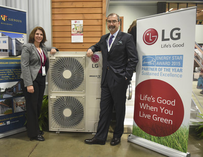 Senior Manager, Sustainability and CSR, Christine Ackerson, left, and Senior Vice President, LG Air Conditioning Systems, Kevin McNamara, right, stand next to an energy efficient LG HVAC system at the Greenbuild International Conference & Expo on Wednesday, Nov. 18, 2015 in Washington. LG, one of the Energy Star(R) Partner of the Year 2015, is also a sponsor of the Greenbuild International Conference & Expo. (Kevin Wolf/AP Images for LG Electronics)