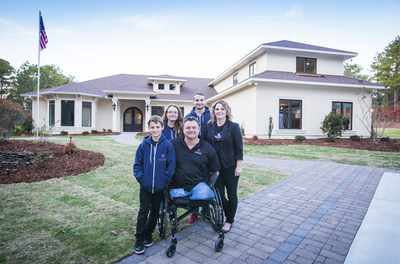 Triple amputee MSG John Masson and his family outside their new specially adapted Smart Home in Southern Pines, North Carolina, courtesy of Building for America's Bravest - a partner program between the Gary Sinise Foundation's R.I.S.E. program and Stephen Siller Tunnel To Towers Foundation