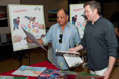 Actor and avid art collector Cheech Marin (left) along with Ian Cartabiano, chief designer at Toyota's Calty Design Studio, critique artwork submitted by youth from across the country for the Toyota Dream Car Art Contest, March 14, 2013, at Toyota's U.S. headquarters in Torrance, Calif.  (PRNewsFoto/Toyota Financial Services)