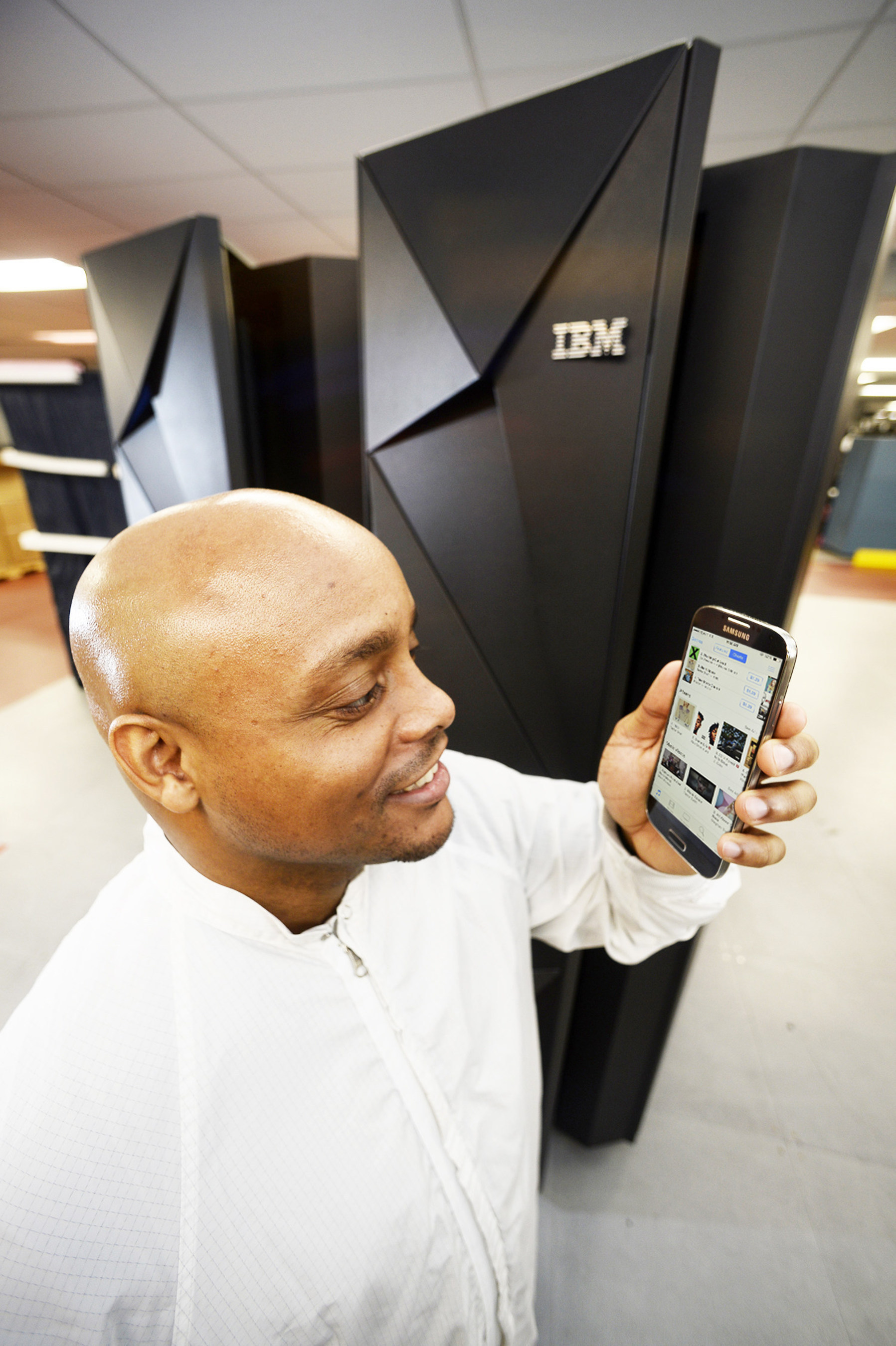 January 14, 2015 - At IBM's manufacturing facility in Poughkeepsie, NY, software developer Moses Vaughan tests a mobile app that is running on IBM's new z13 mainframe, one of the most sophisticated computer systems ever built. It culminates a $1 billion investment, five years of development, and includes more than 500 new patents and represents a collaboration with over 60 clients, underscoring IBM's commitment to providing higher-value, innovative technology for clients. (Jon Simon/Feature Photo Service for IBM)