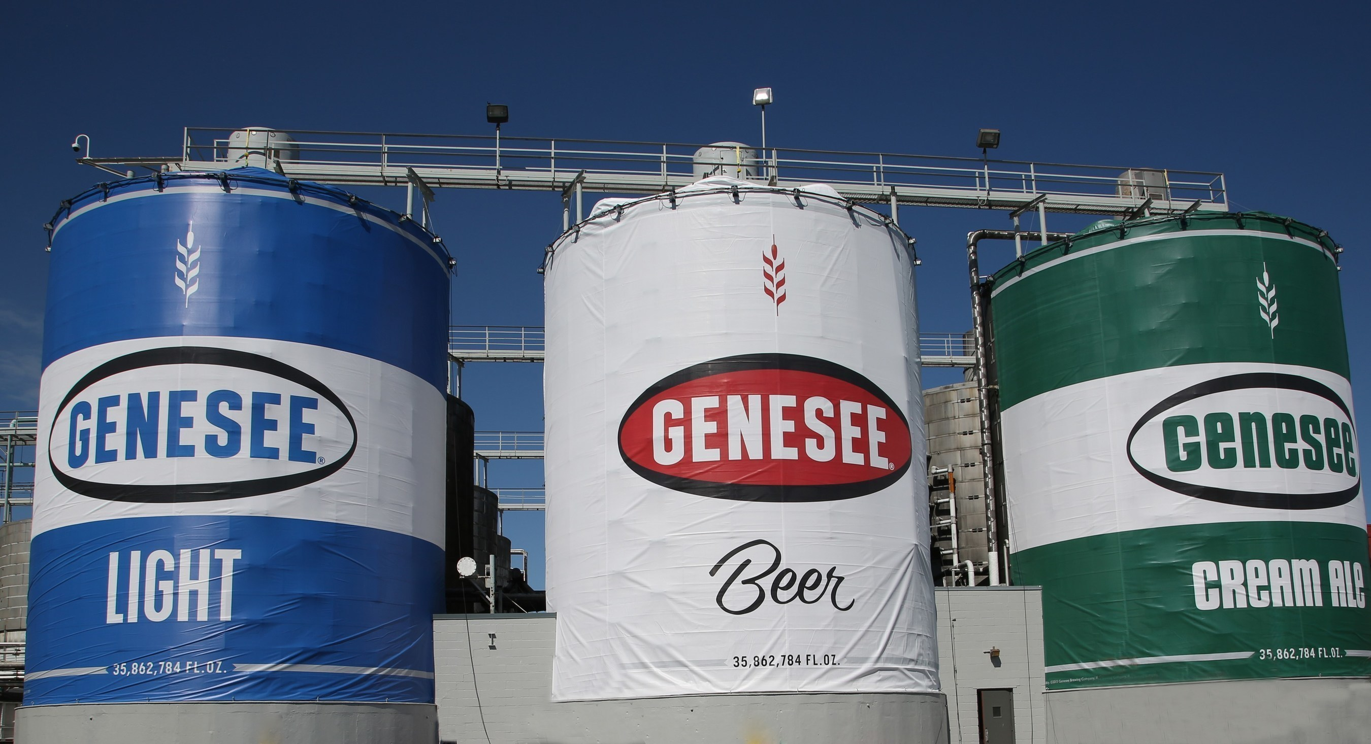 Genesee Brewery takes innovative look to three-story-heights, creating huge versions of popular family of beers .