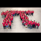 More than 100 middle school students from the MATHCOUNTS program stand in formation of the Greek letter Pi in celebration of Pi Day. The date, March 14 or 3.14, represents the first three digits of Pi, which is used in mathematics to express the ratio of a circle's circumference to its diameter. As part of Raytheon's MathMovesU(R) initiative, the company observes Pi Day to highlight the significance of pi calculations in science, technology, engineering and math to the next generation of innovators.