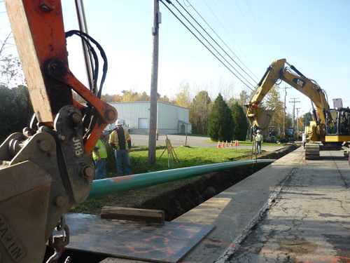 Construction crews from Summit Natural Gas of Maine install a portion of pipeline in the Kennebec Valley that ...