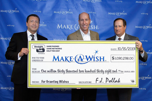 FJ Pollak (R), TracFone Wireless, Inc. CEO, and Gustavo Blanco (L), TracFone Wireless, Inc. Vice Chairman, present David Williams (C), Make A Wish CEO, with a check as Straight Talk Wireless Donates Over $1,000,000 To Make-A-Wish on October 15, 2013 in Phoenix, Arizona.  (Photo by Mike Moore/Getty Images for Straight Talk Wireless).  (PRNewsFoto/Straight Talk Wireless)