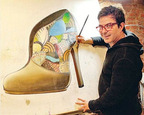 """Helio de Sousa working on one of his """"Shoe Has Soul"""" paintings in his Manhattan studio.  (PRNewsFoto/New York Latin Culture Media)"""