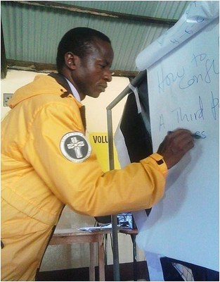 Scientology Volunteer Minister from Kenya is providing seminars to neighbors and nearby villages