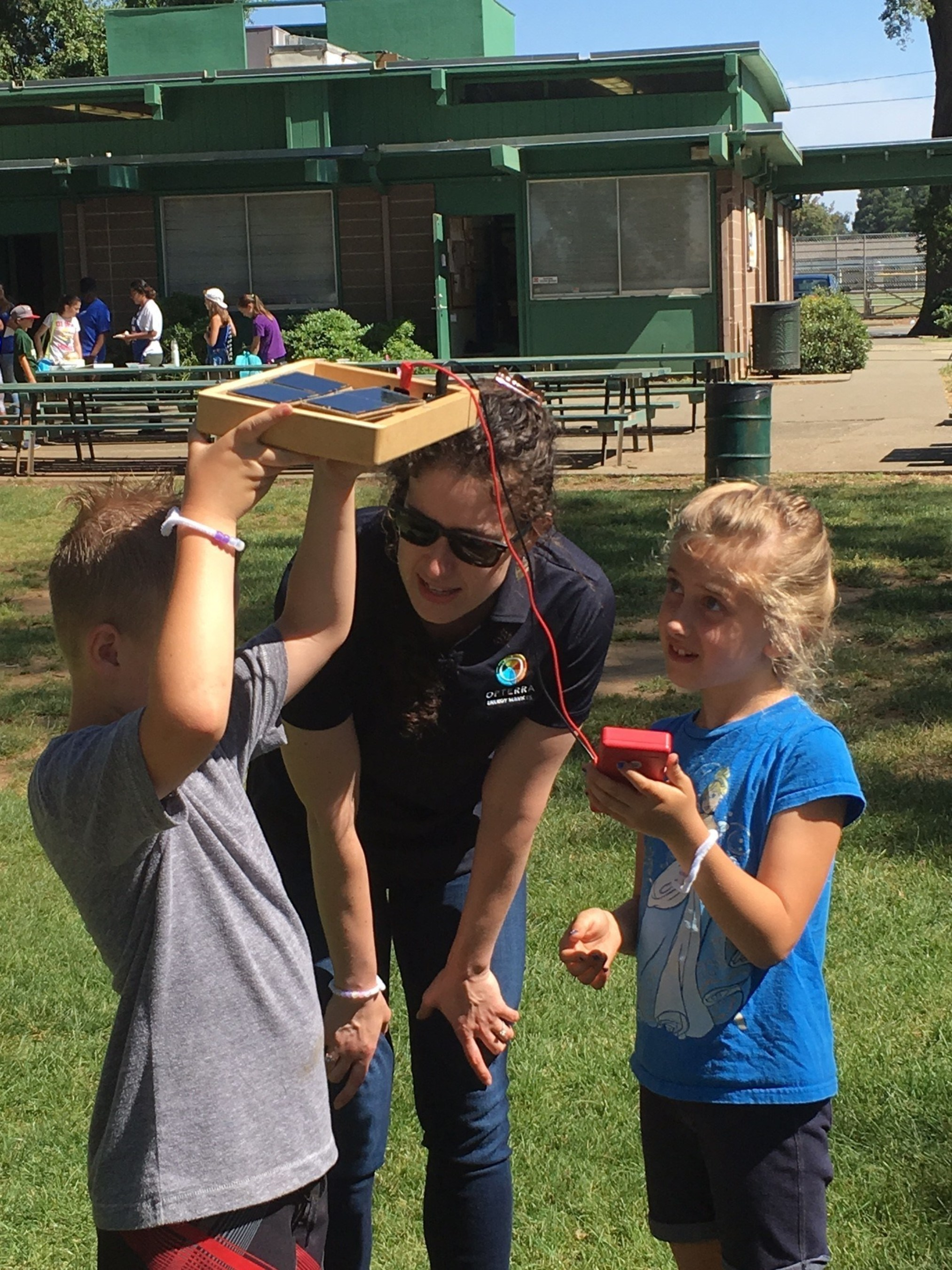 "OpTerra Energy Services Education Team member teaches Cosumnes CSD residents about the science behind solar energy at this year's ""Weird Science"" camp."