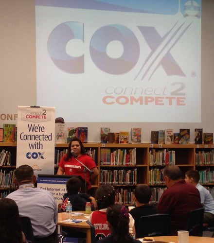 Yvonne Gomez shares her family's story of how broadband Internet has benefited her children's education at a reception with Cox Communication at the Los Amigos Technology Academy in Tucson, Arizona. Cox is rolling out its Connect2Compete internet offer as part of its support of the non-profit's broadband adoption effort.  (PRNewsFoto/Cox Communications)