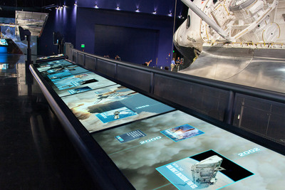 "The Space Transportation System Timeline uses six 52"" interactive touchscreen monitors to place the history of the Space Shuttle Program right at a guest's fingertips."