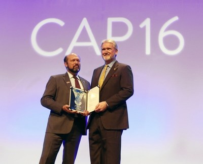 College of American Pathologists President Richard C. Friedberg, MD, PhD, FCAP presents Gene N. Herbek, MD, FCAP, the Pathologist of the Year Award at CAP16, then annual meeting of the CAP
