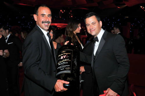 Emmy host Jimmy Kimmel signs 27 liter etched bottle of 2009 Georges de Latour, held by Beaulieu Vineyard Director of Winemaking Jeffrey Stambor at the 64th Primetime Emmys(R). Bottle features signatures by Emmy winners and nominees and will be sold to benefit The Academy of Television Arts & Sciences Foundation.  (PRNewsFoto/Beaulieu Vineyard)