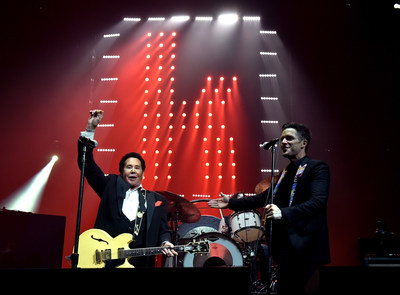 Brandon Flowers w. Wayne Newton at T-Mobile Arena Grand Opening. Photo credit Kevin Winters Getty. ABA: Mr. Las Vegas, Wayne Newton, joined The Killers during their set for a collaboration of