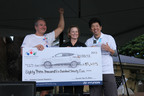 Marc Garvey (left), Hyundai Hope On Wheels board member and dealer owner of Garvey Hyundai, and Mickey Pong (right), vice chairman of Hyundai Hope On Wheels and dealer owner of North County Hyundai present Martha Smith (center), chief operating officer of Kapi'olani Medical Center, with a check in the amount of $83,625 for pediatric cancer research at the Hyundai Hope On Wheels 5K in Maui on Saturday, January 5, 2013.  (PRNewsFoto/Hyundai Hope on Wheels)