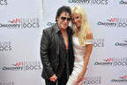 "Journey Lead Guitarist Neal Schon & Girlfriend, Reality Starlet Michaele Salahi walk the Red Carpet at Journey movie ""Don't Stop Believin: Everyman's Journey"" premier at Discovery Channel/AFI Silverdocs Film Festival, Washington, DC - Photo Credit: www.glittarazzi.com.  (PRNewsFoto/LLEWMORC Media & Production Agency)"