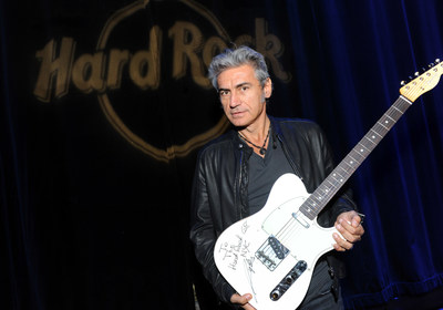 "Italian singer-songwriter, film director and writer Luciano Ligabue donates his Fender Telecaster White guitar, which he played during a New York performance of his ""Mondovisione Tour - Mondo 2014,"" to Hard Rock's world famous memorabilia collection while at Hard Rock Cafe New York, Monday, Oct. 20, 2014.  (Photo by Diane Bondareff/Invision for Hard Rock International/AP Images)"