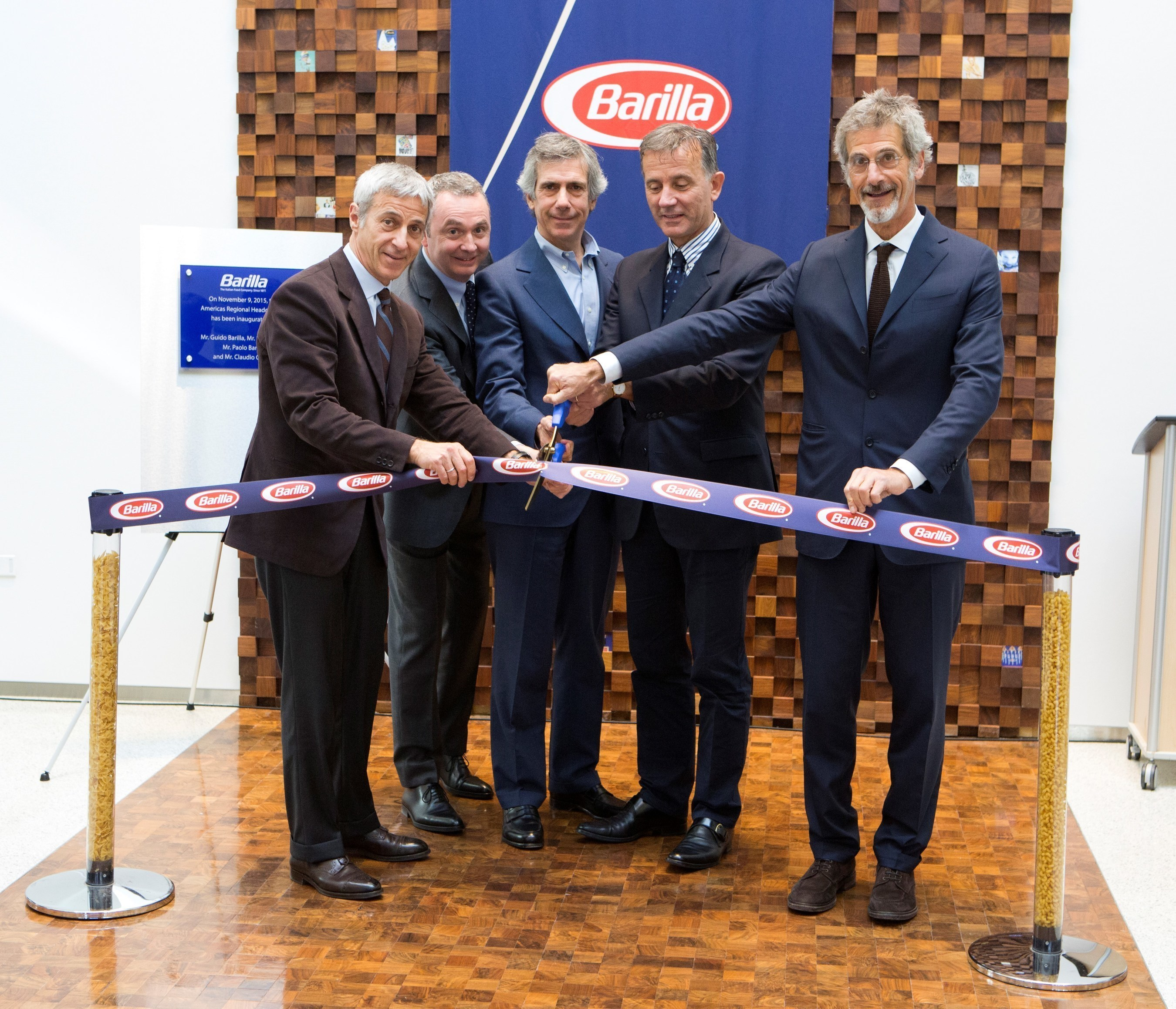 """Barilla leaders celebrate the grand opening of their new Region Americas Headquarters at 885 Sunset Ridge Rd., in Northbrook, Ill., designed to foster collaboration with an """"outside-in"""" approach-key to Barilla's growth strategy. (From left: Vice Chairman Luca Barilla, Region Americas President Jean-Pierre Comte, Vice Chairman Paolo Barilla, CEO Claudio Colzani, Chairman Guido Barilla)."""