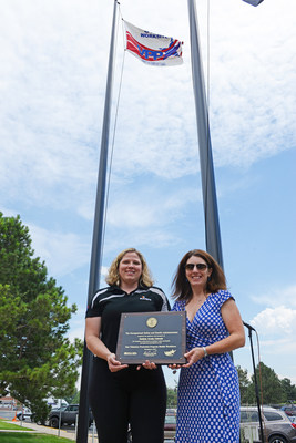 OSHA representative Meghan Meger and Sundyne EH&S manager Jenelle Mote pose with the VPP Star site recertification plaque in front of the Arvada, CO manufacturing facility. (PRNewsFoto/Sundyne)