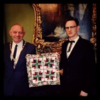 JD Wilkes presents quilt to the Lord Mayor of Dublin, Ireland (PRNewsFoto/The National Quilt Museum)