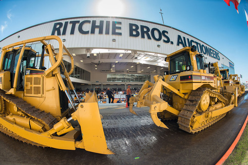 A line-up of crawler tractors on the Ritchie Bros. auction ramp at the worlds largest heavy equipment auction of 2014 in Orlando, FL  February 17  22, 2014 (PRNewsFoto/Ritchie Bros. Auctioneers)